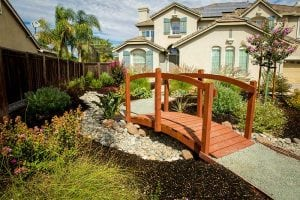 Landscape design with walking bridge - front yard